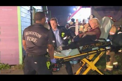 Firefighters rescue woman from air vent of Houston house