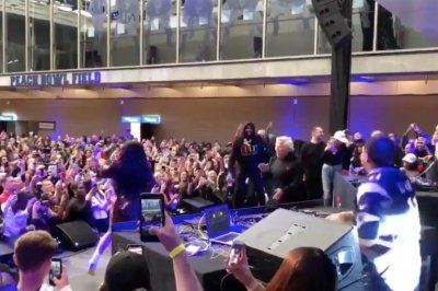 Patriots owner Robert Kraft dances with Cardi B at Super Bowl party