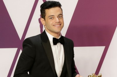 Rami Malek falls off stage at Oscars, treated by paramedics