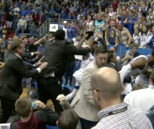 Kansas' blowout victory over rival Kansas State ends with brawl