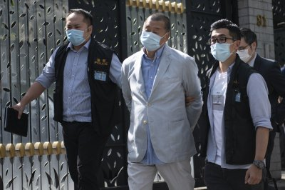 Hong Kong police arrest media tycoon under new security law