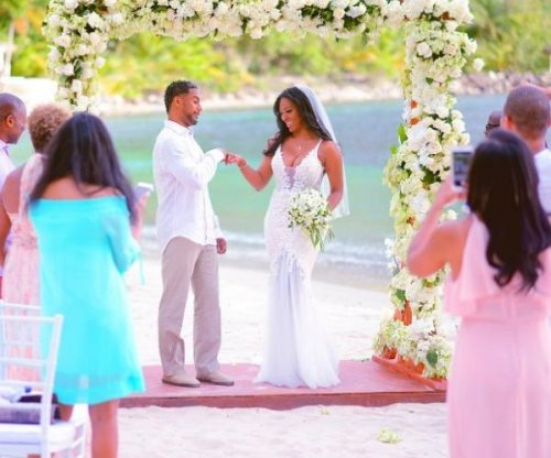 Kenya Moore shows husband for first time in new wedding photo
