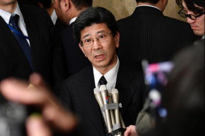 Family of Japanese official who died by suicide sues Tokyo