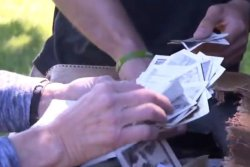Briefcase of old photos rescued from trash at New York park, returned to family