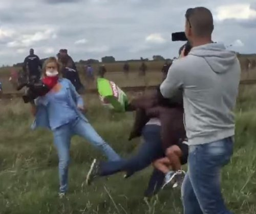 Photographer caught tripping refugees sentenced to probation