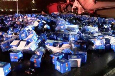 Bud Light cases spill onto New York street after truck flips