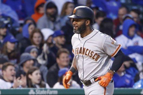 San Francisco Giants outlast struggling Colorado Rockies in 14 innings