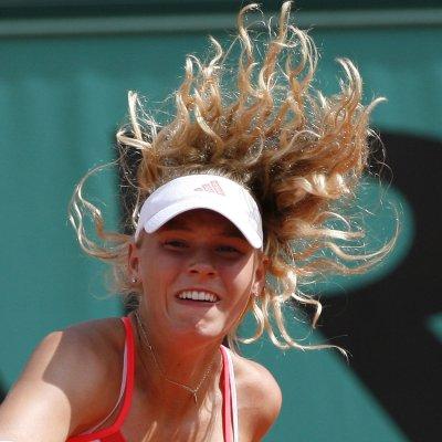 Wozniacki claims first WTA title