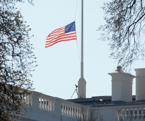 Nancy Reagan's children pay tribute; White House flag lowered to half-staff