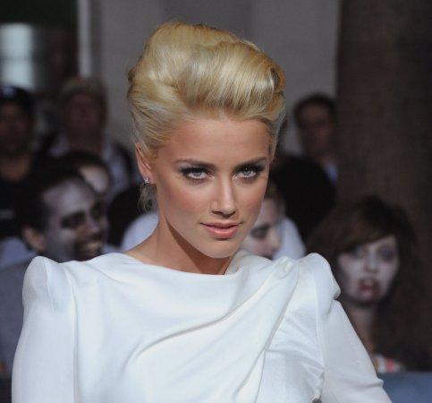 Amber Heard reveals she's a lesbian