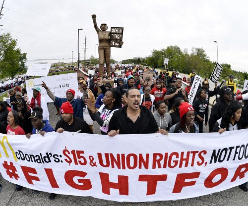 Minimum wage protesters march on McDonald's headquarters