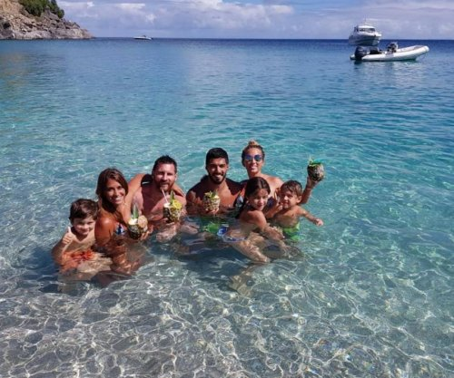 Barcelona teammate Luis Suarez joins Lionel Messi on honeymoon