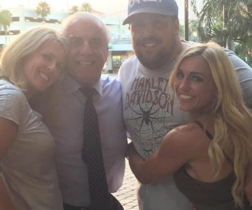 Charlotte Flair on dad Ric Flair's hospitalization: 'Our dad is a fighter'