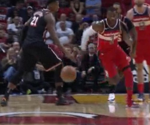 John Wall: Washington Wizards star dribbles between Hassan Whiteside's legs