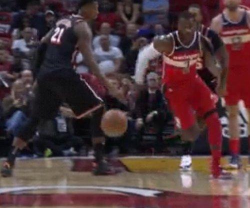 John Wall: Washington Wizards star dribbles between Hassan Whiteside's legs