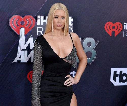 Iggy Azalea teases new album, releases cryptic artwork