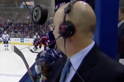 NHL commentator Pierre McGuire barely avoids puck flying toward face