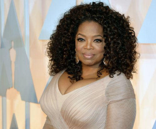 Oprah displays weight loss progress on cover of O Magazine