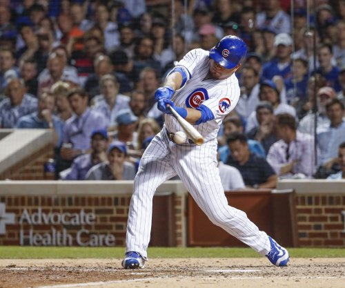 Kyle Schwarber's blast helps Chicago Cubs top Cincinnati Reds