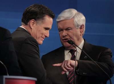 Romney defends against rival criticism