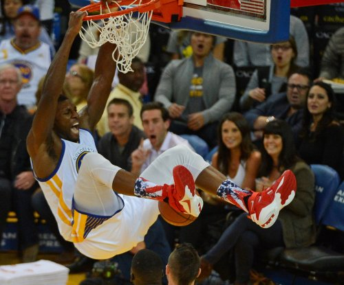 Golden State Warriors work OT to extend streak