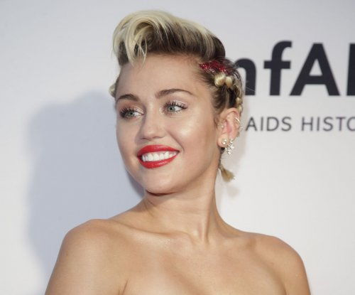 Miley Cyrus says she's proud of coming out