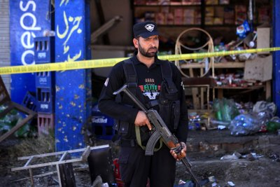 Three bombers, two officers dead in attack at Pakistani court