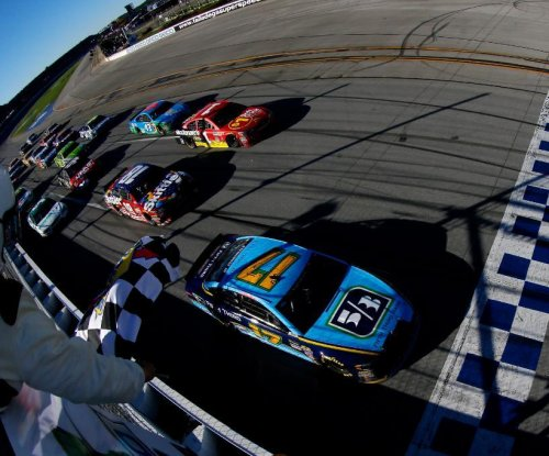 Ricky Stenhouse uses late pass to win Geico 500