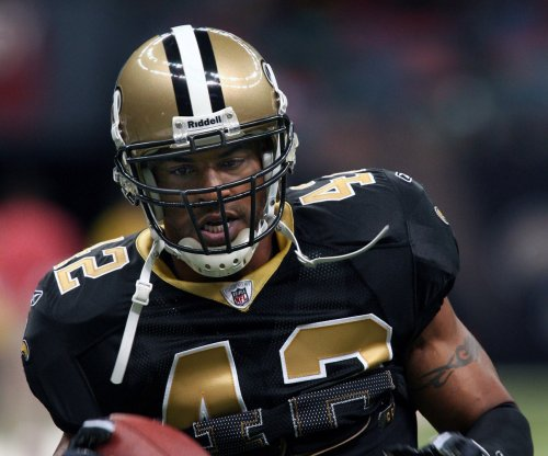 Former NFL star Sharper sentenced to 9-year prison term