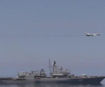 Russian warplanes fly near U.S. destroyer off Crimean coast