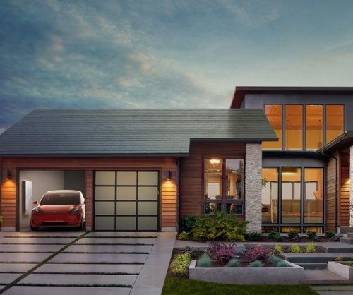 Tesla unveils sleek glass solar roof tiles