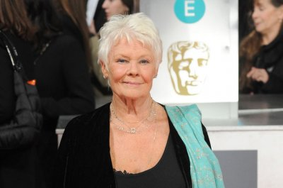 Judi Dench 'tempted' to get first tattoo