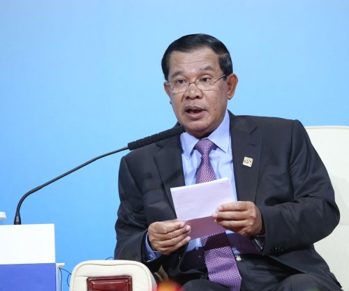 Cambodian senator, facing alleged treason, in hiding