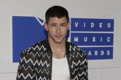 Nick Jonas supports Joe Jonas at 2016 MTV VMAs