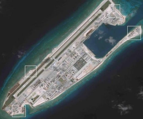 China builds shelters for missile systems in South China Sea