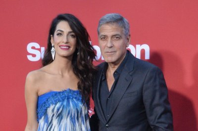George and Amal Clooney donate $500K to gun control march
