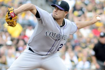 Jorge De La Rosa pitches Colorado Rockies past Pittsburgh Pirates