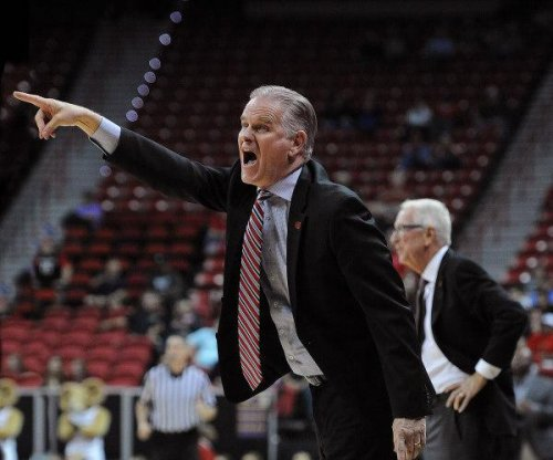 San Diego State's Steve Fisher retires, replaced by Brian Dutcher
