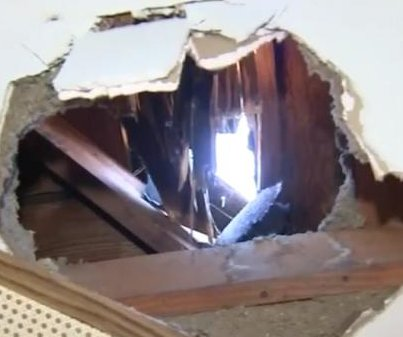 Huge ice chunk, possibly from plane, crashes through roof