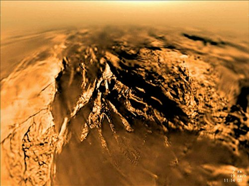 Spacecraft data suggest Saturn moon Titan has thick, rigid ice shell