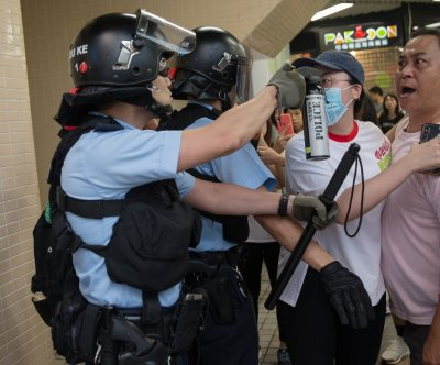 Hong Kong pro-democracy protesters clash with rivals
