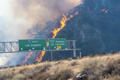 Subsided winds aid firefighters in fight against deadly wildfires in California