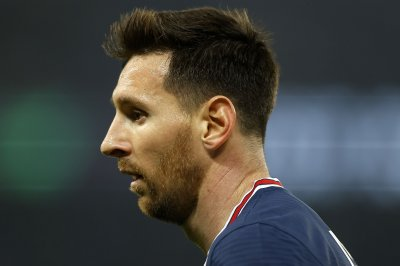 Soccer: Lionel Messi injures knee bone; status in doubt for Champions League
