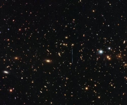 Hubble image showcases cluster with mass of three million billion suns
