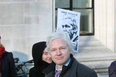 Ecuador warns Assange to obey rules or lose asylum