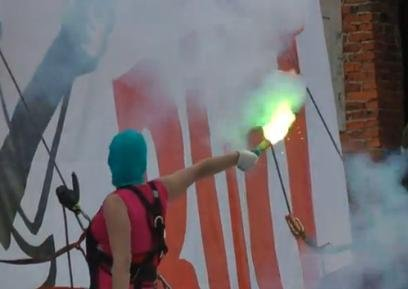 Pussy Riot protesters burn Putin banner