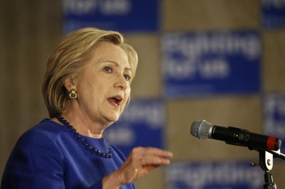 Clinton says she'll go further than Obama on immigration