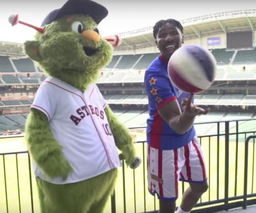 Harlem Globetrotters sink shot from rafters of Minute Maid Park