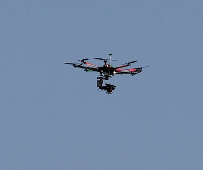 Woman forced to pay damages after throwing rocks at neighbor's drone