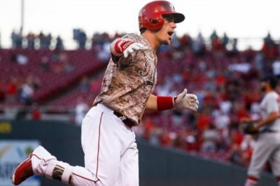 Scooter Gennett hits historic 4 homers, drives in 10 as Cincinnati Reds rout St. Louis Cardinals